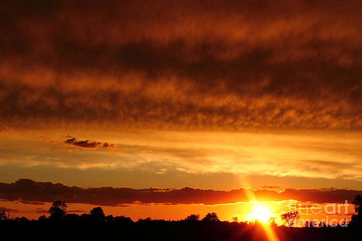 Sunset Beneath the Clouds by Deanna Wright