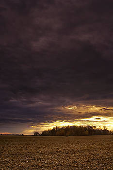 Sunset during passing strom in central Indiana by Michael Huddleston