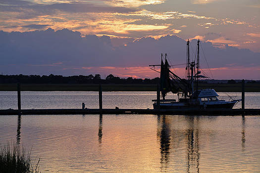 Sunset on Jekyll Island with Boat Reflection 02 by Bruce Gourley