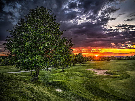 Sunset over golf field by IP Maesstro