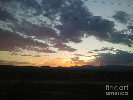 sunset over looking Fort Carson by Greg Davis