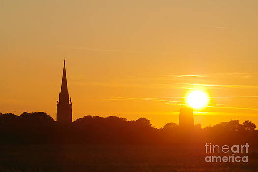 Sunset over Patrington Church in Yorkshire by Tess Baxter