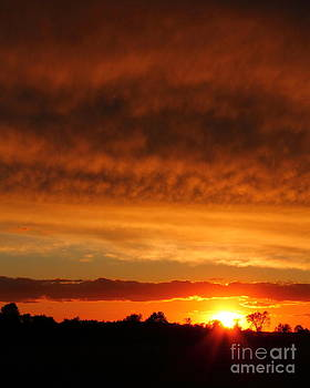 Sunset Under the Storm by Deanna Wright