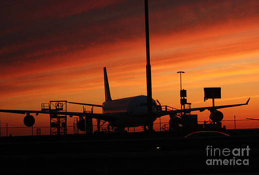 Sunset. Vulcanic ash cloud closing down airport by Sara  Meijer