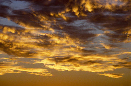 Sunset with cloudy sky by Patrick Kessler