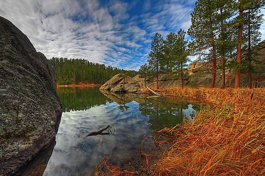 Sylvan Lake Reflections by Chris  Allington