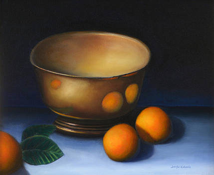Tarnished silver bowl and oranges by Jennifer Richards