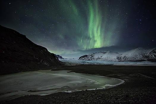 The Aurora Borealis Over A Glacier by Alex Saberi