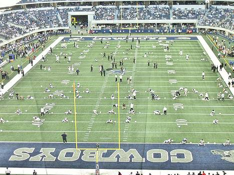 Dallas Cowboys and Oakland Raiders  by Donna Wilson