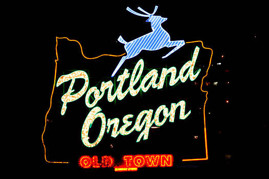 The New Portland Oregon sign at night with white lights by DerekTXFactor Creative