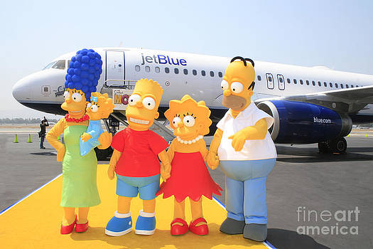 The Simpsons are ready to board their plane by Nina Prommer