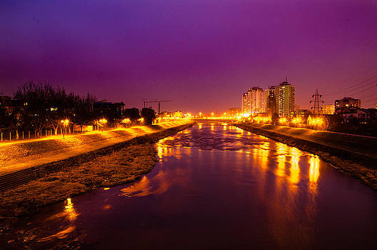The Vardar river in Skopje at night. by Slavica Koceva
