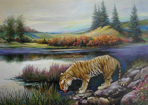 Tiger by the river by Svitozar Nenyuk
