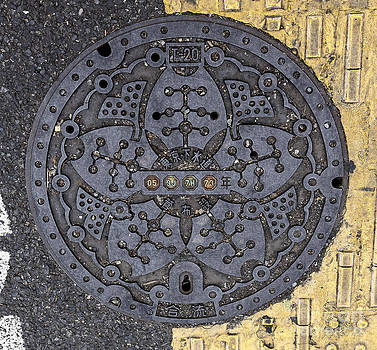 Tokyo Manhole by Scott Kerrigan