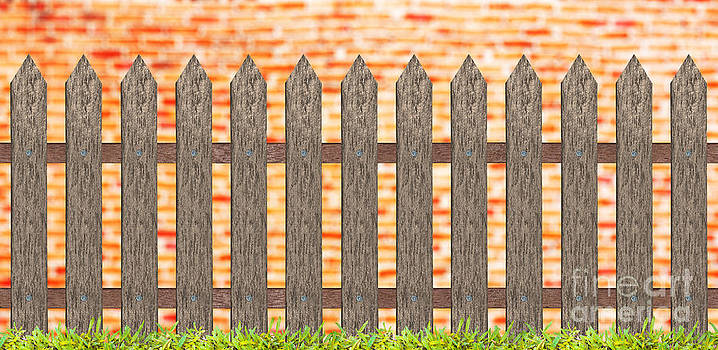 Traditional Fence With Grass And Brick Wall by Pakorn Kitpaiboolwat