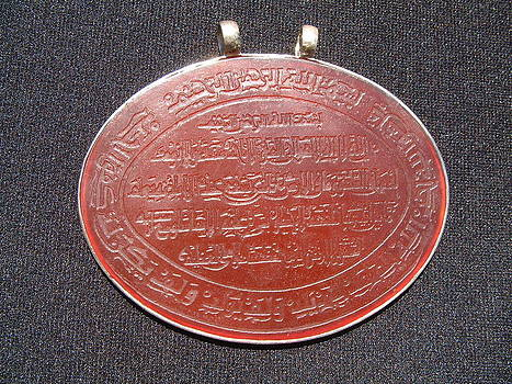 Turkoman silver pendant decorated with large carnelian plaque featuring an inscription from Koran by Turkoman silversmith master