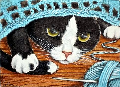 Tuxedo Cat laying in wait... by Debrah Nelson
