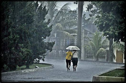 Two Ladies With One Umbrella by Achmad Bachtiar