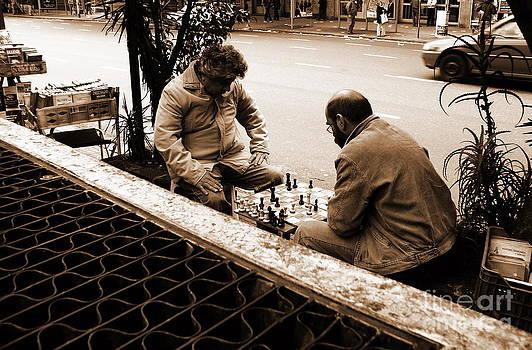 Two men playing chess  by Gonzalo Teran