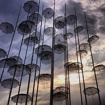 Umbrellas in the sky by Emmanuel Varnas