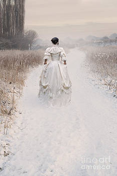 Victorian Woman Walking Through A Winter Meadow by Lee Avison