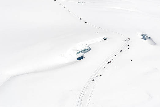 walking path on snow covered Jungfrau mountain by Jirawat Cheepsumol