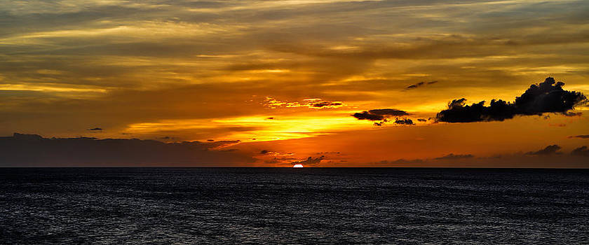 Watching the sun set in Barbados  by Craig Bowman