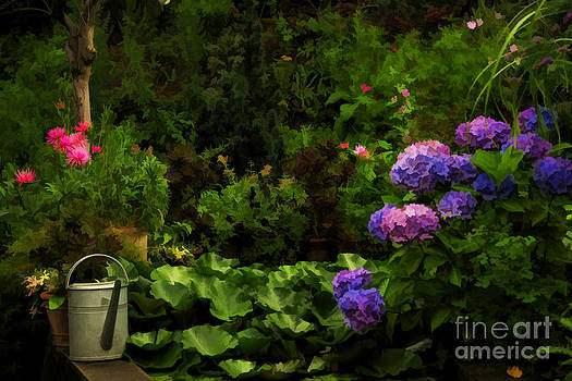 Watering can in a beautiful garden by Gry Thunes