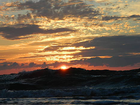Wave breaking as the sun rises by Linda Brown