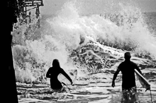 Waves Break at pier by DM Werner
