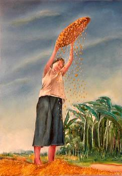 Woman Sifting Palay by Miriam Besa