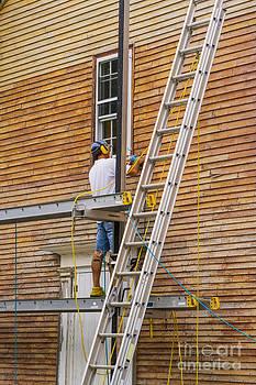 Patricia Hofmeester - Wood sanding the house