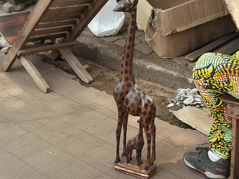Wooden Giraffe by Hilary Bime