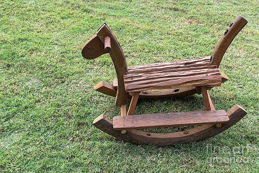 Wooden rocking horse by Tosporn Preede