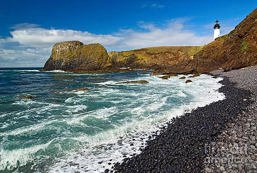 Jamie Pham - Yaquina Lighthouse on top of rocky beach