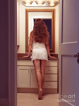 Young sexy woman at a bathroom mirror by Oleksiy Maksymenko