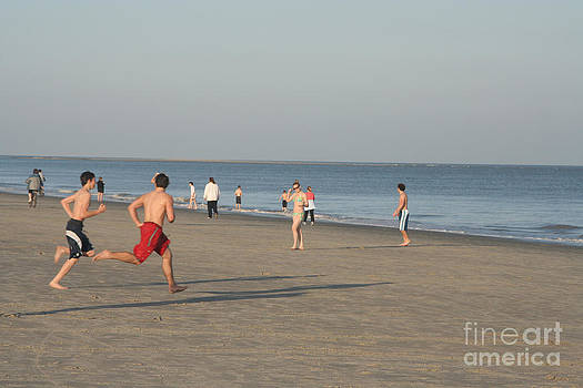 Youth Playing on the Beach at Hilton Head South Carolina by Thomas Marchessault