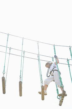 Sami Sarkis - Girl walking on suspended footbridge