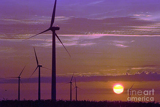 Wind turbines at sunset by Jim Wright