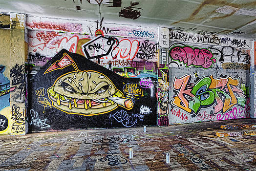 Graffiti Adorns Walls Of A Parking by Douglas Orton