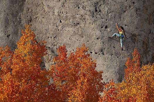 A Female Climber On A Cliff Wall by Bill Hatcher