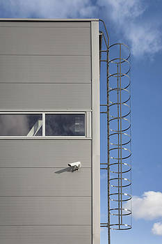 A Metal Ladder Leading Up To The Roof by Jaak Nilson