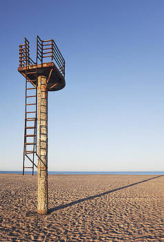 A Rusting Lifeguard Tower On An Empty by Greg Stechishin