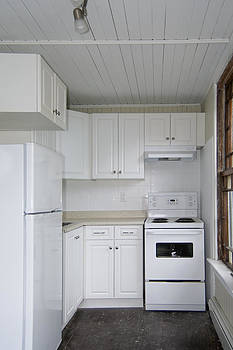 A Small Galley Kitchen In An Old by Will Burwell