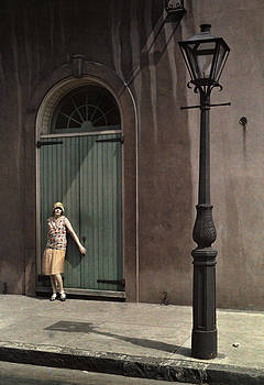 A Woman Standing By The Doors by Edwin L. Wisherd