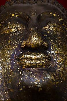 ancient Buddha face Ayutthaya Thailand  by Wasan Gredpree