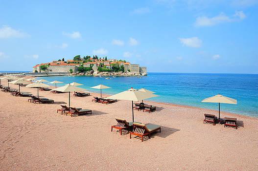 Beach near Sveti Stefan island in Montenegro by Roman Rodionov
