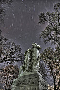 Beyond the Grave - Star Trails Over Statue by Jeramie Curtice