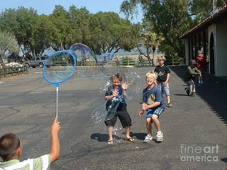 Blowing Bubbles by Joan  Jones