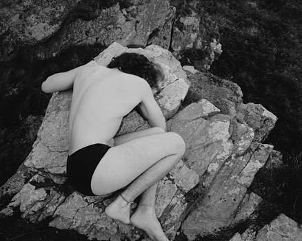 Body on a rock by Marcio Faustino